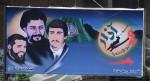 Amal-propaganda. De middelste van de drie portretten links is Musa al-Sadr.