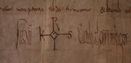 Handtekening van Karel de Grote. Dit soort monogrammen waren de Late Oudheid en Vroege Middeleeuwen heel gangbaar en zeggen niets over Karels veronderstelde analfabetisme.
